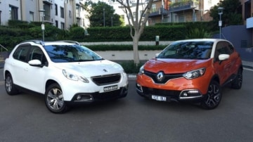 Close run: The Peugeot 2008, left, is edged out overall by the Renault Captur.