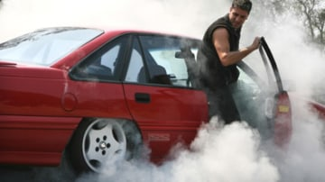 """Picture: Where there's smoke, there's action: Matt gets the rubber on his Commodore smoking. """"It's all in good fun - no money, no grudging. Pure fun."""" Picture: Angela Wylie"""