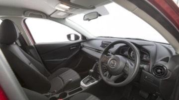 Inside the 2015 Mazda2 Neo sedan.