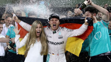Mercedes driver Nico Rosberg celebrates with his wife Vivian after claiming the world title.