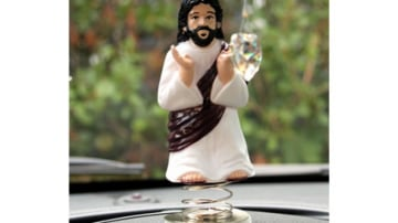 "Driving under the watchful gaze of ""Dashboard Jesus"""