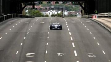 Australian Formula One driver Mark Webber drives his BMW-Williams vehicle across the Sydney Harbour Bridge