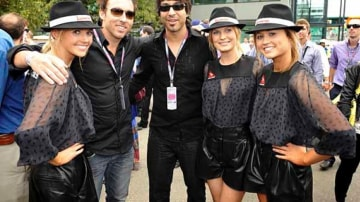 Comedians Eddie Ifft and Arj Barker with the Qantas girls.