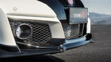 The Civic Type R features large air intakes and an almost flat underbody improve aerodynamics.