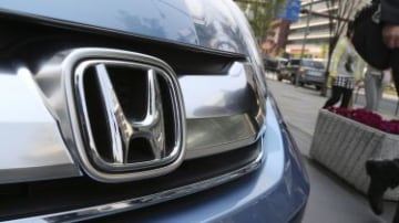 A man walks past a Honda on display at Honda headquarters in Tokyo. Honda recalled an additional 4.89 million vehicles around the world forr a new type of problem in Takata air bag inflators, for which Japanese rivals Toyota and Nissan have already carrie