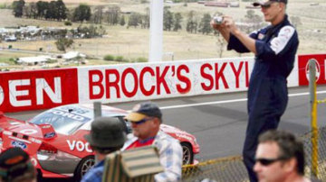 For the scrapbook ... A fan takes a photo of the tribute to Peter Brock.