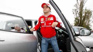 Ferrari driver Felipe Massa arrives at the track.