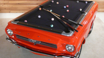 A recycled vintage Mustang has been turned into a pool table.