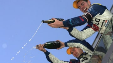 Bubbling over with joy, Jamie Whincup and Craig Lowndes celebrate their success in