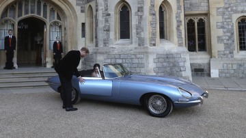Prince Harry and Meghan Markle with the electric-powered Jaguar.