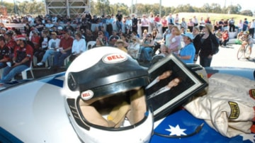 Hundreds of Peter Brock fans parade their Holdens down Pit Lane at Mount Panorama in Bathurst, Tuesday Sept. 19, 2006.