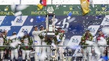 The Porsche team celebrate their victory.