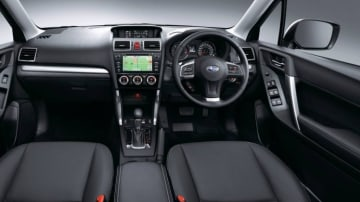 The Forester's interior feels conservative in the company of the Tuscon.