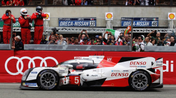 Race leader Kazuki Nakajima of Toyota Gazoo Racing suffers engine problems on the main straight at the end of the Le Mans 24 Hour race handing victory to the Porsche Team.
