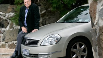 Ron Barassi and his Nissan Maxima.