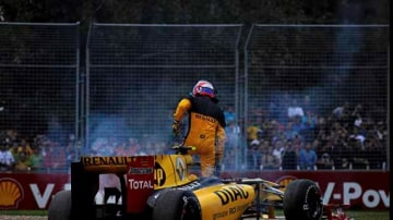 Vitaly Petrov (Renault) comes off at turn three. Vitaly getting out of his car.