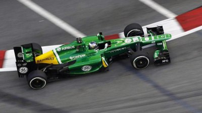 F1: Caterham Confirms Sale, Ecclestone Points To Ferrari For Vettel