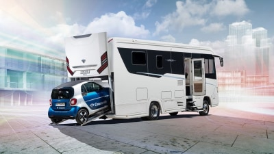 Motorhome with its own car port: $500,000 and counting