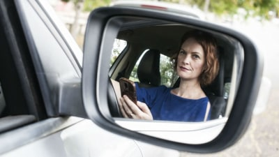 Parents Setting Bad Example With Mobile Phones While Driving: QUT