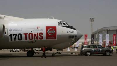 Nissan Patrol Tugs Cargo Plane Into The Record Books: Video