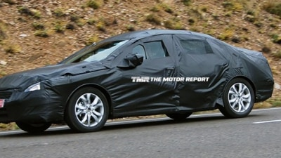 2011 Peugeot 408 Spied Testing In Heavy Camouflage