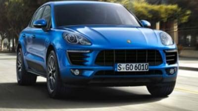 Porsche unveils mini SUV