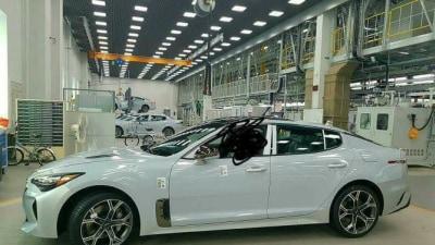 Rear Wheel Drive Kia Sedan Spied In Pre-Production Guise