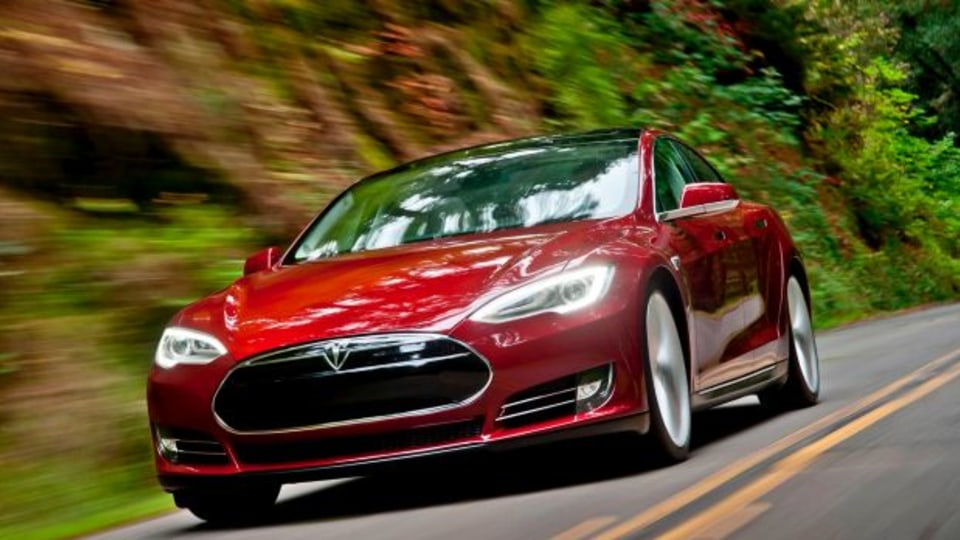 Elon Musk says self-driving Tesla cars will be in the US by summer