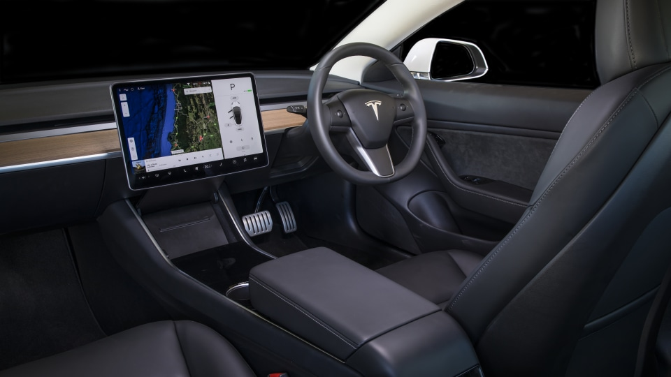 Drive Car of the Year 2020 best electric vehicle Tesla Model 3 interior driver seat steering wheel and infotainment system