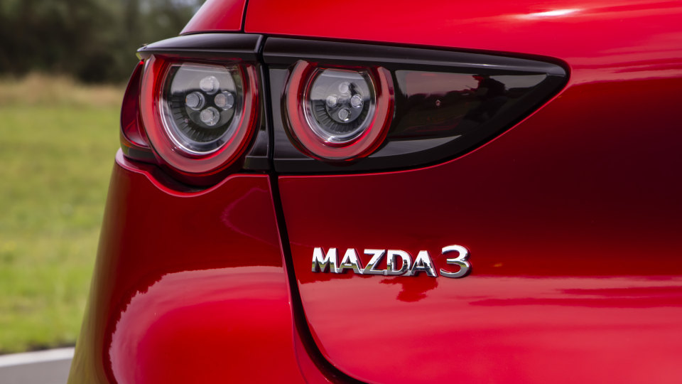 Drive Car of the Year Best Small Car of 2021 finalist Mazda 3 left tail light and label close-up