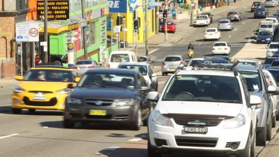 Benefit in doubt: traffic on Parramatta Road near Leichhardt.