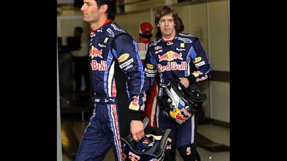 Mark Webber (2nd place) and Sebastian Vettel (1st place) after qualifying.