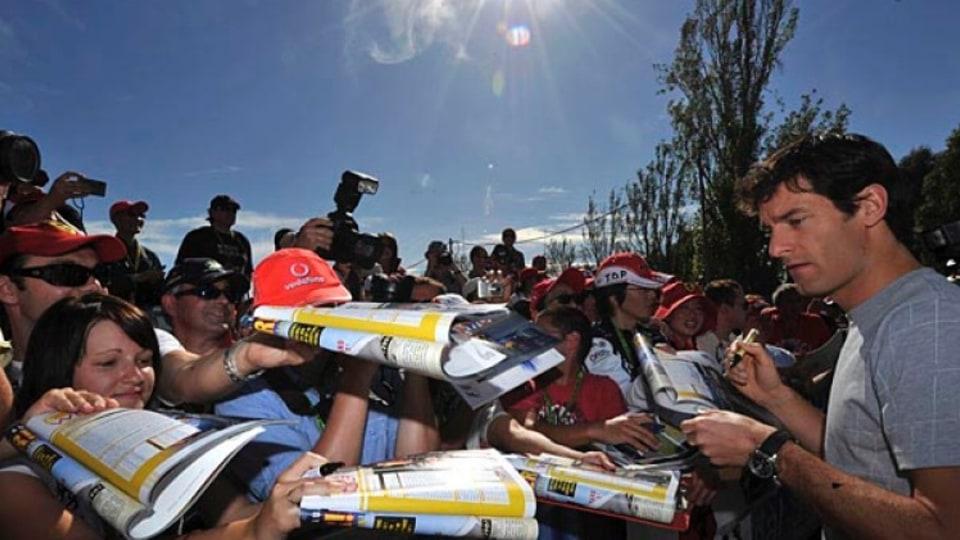 Mark Webber meets fans trackside.
