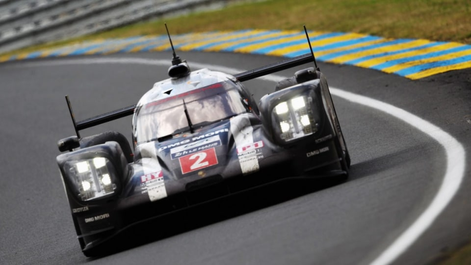The Porsche Team 919 of Neel Jani, Romain Dumas and Marc Lieb drives on its way to winning the Le Mans 24 Hour.