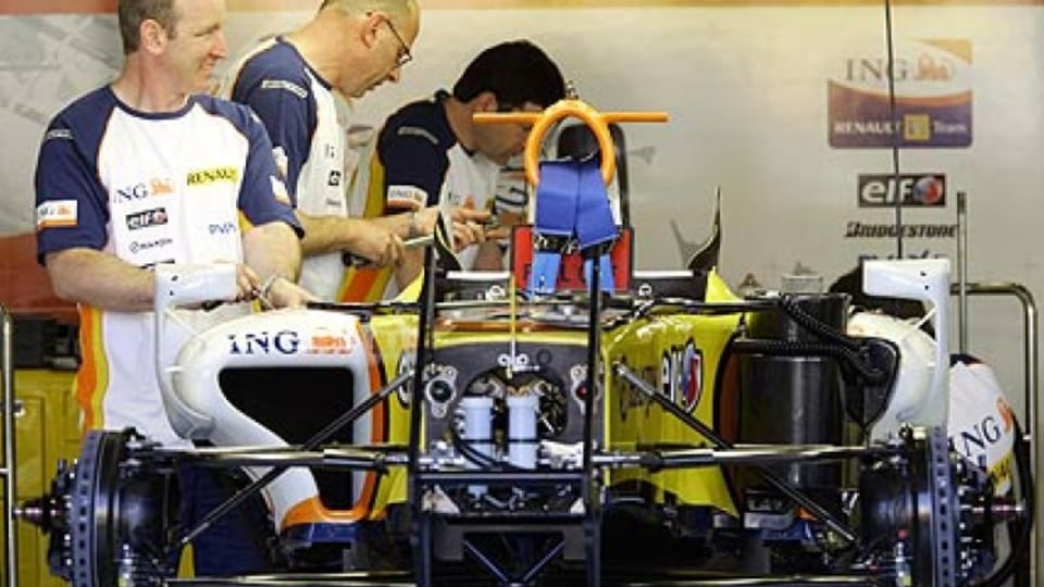 Gearing up ... Renault mechanics prepare for the big race. Photo: AP