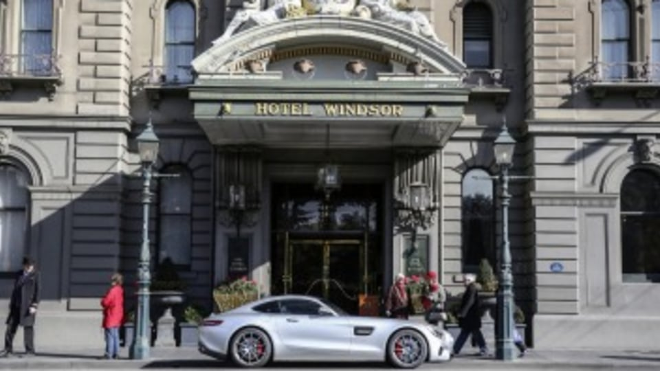 Parked outside the Hotel Windsor, the Mercedes-AMG GT cuts a fine figure.