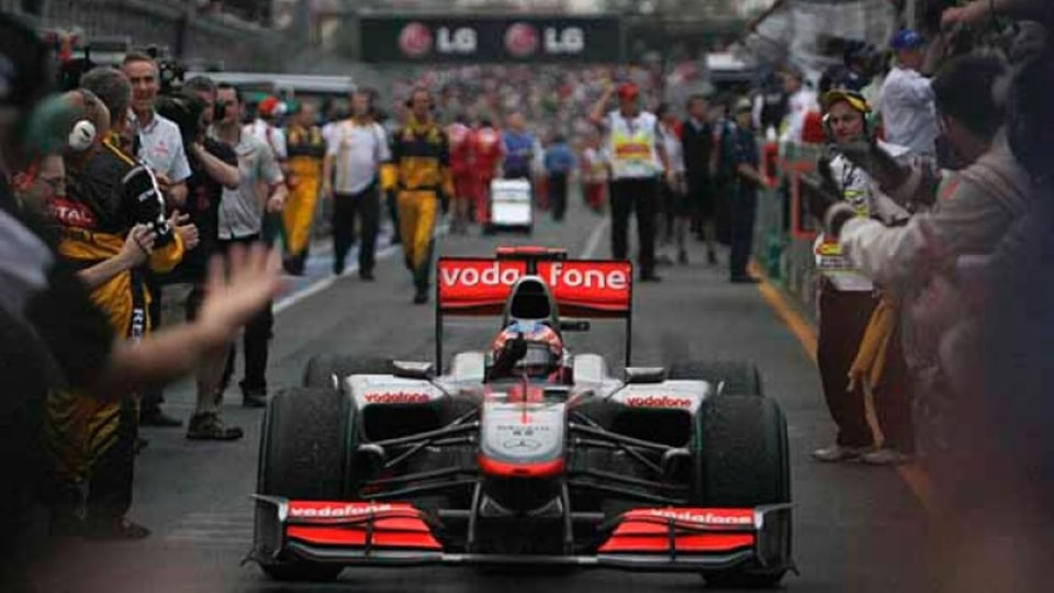 Brawn-Mercedes driver Jenson Button returns to pit lane after winning his second successive GP in Melbourne.