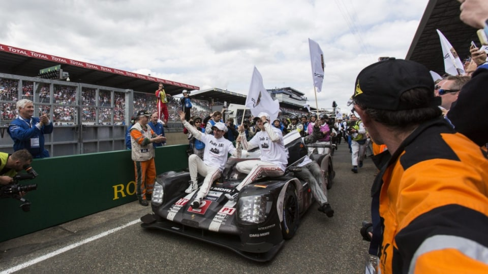 The Porsche 919 Hybrid driven by Neel Jani, Romain Dumas and Marc Lieb celebrate after winning the 84th 24-hour Le Mans endurance race.