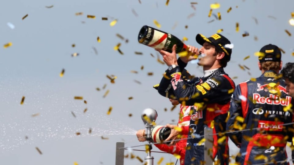 NORTHAMPTON, ENGLAND - JULY 08:  Mark Webber of Australia and Red Bull Racing celebrates on the podium after winning the British Grand Prix at Silverstone Circuit on July 8, 2012 in Northampton, England.  (Photo by Clive Mason/Getty Images)