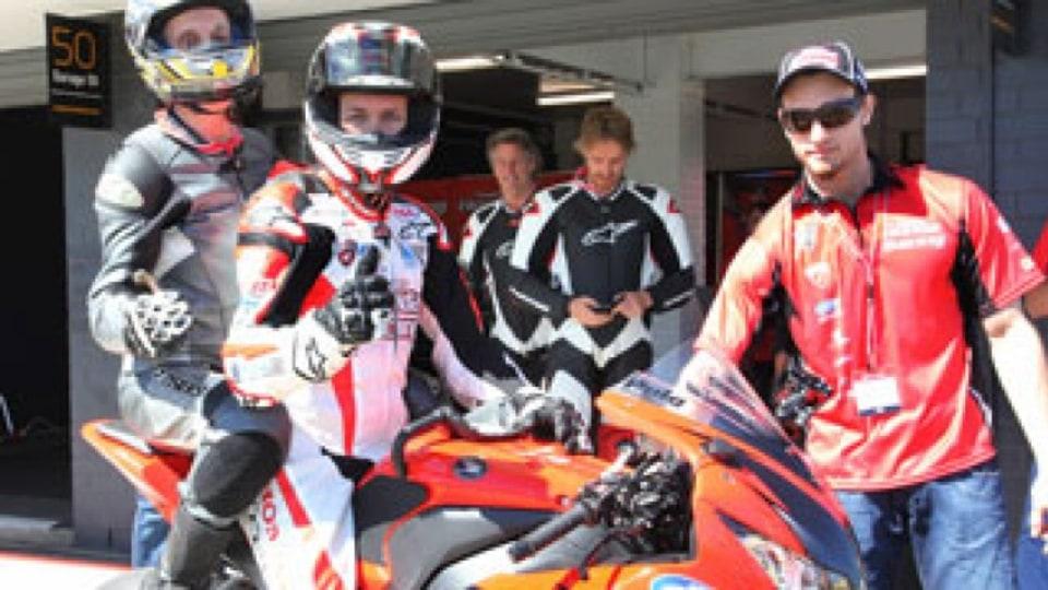 Andrew Downie on the pillion with Team Honda's Australian Superbike star, two-time champion Jamie Stauffer. Photo: Keith Muir.