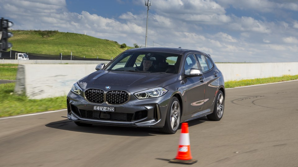 Drive Car of the Year Best Small Luxury Car 2021 finalist BMW 1-Series exterior on road circuit