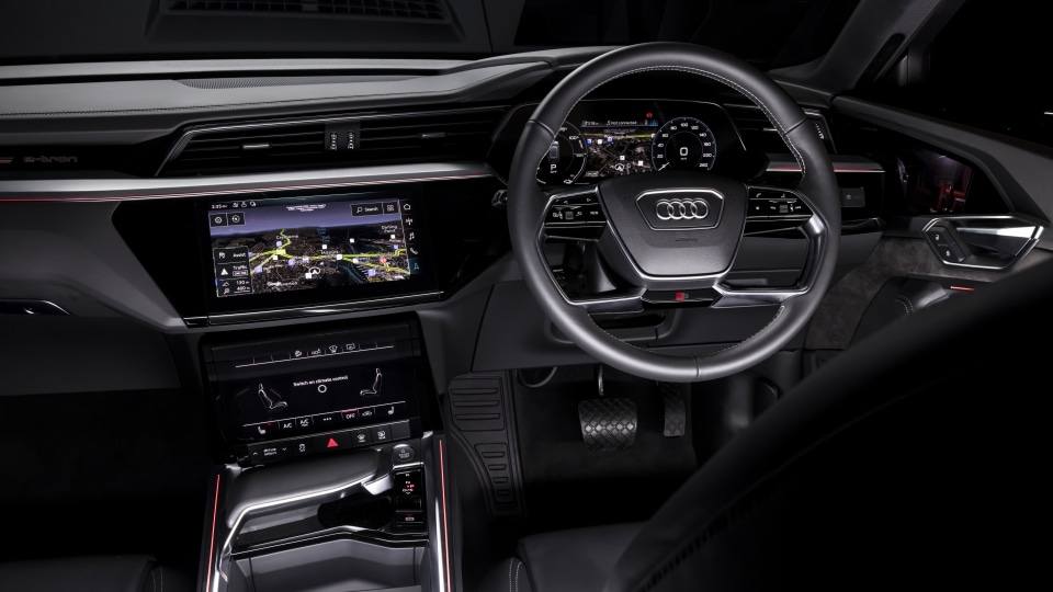 Drive Car of the Year Best Electric Vehicle 2021 finalist Audi e-Tron infotainment system, dashboard and steering wheel.