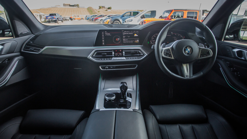 Drive Car of the Year Best Large Luxury SUV 2021 finalist BMW X5 front seating infotainment system, gear shift and steering wheel