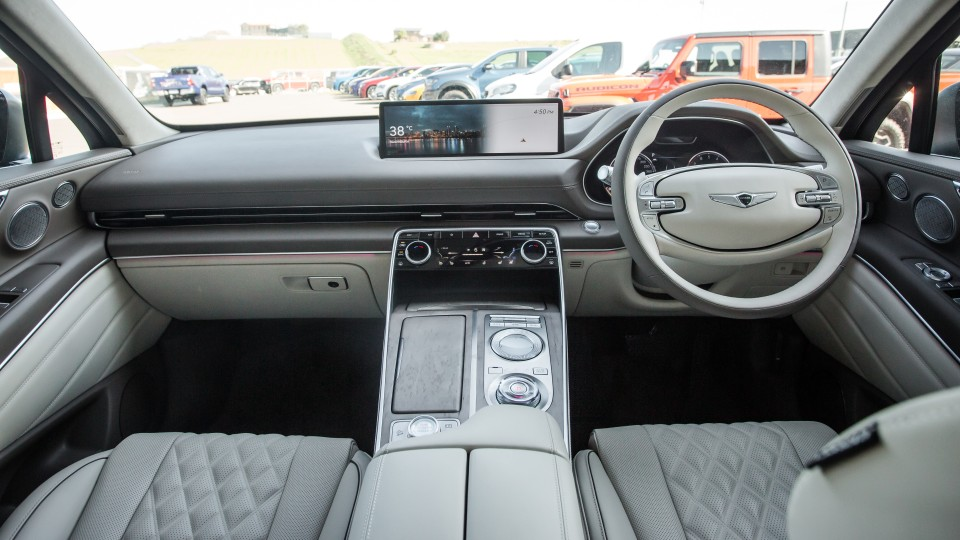 Drive Car of the Year Best Large Luxury SUV 2021 finalist Genesis GV80 front interior view of infotainment system and steering wheel