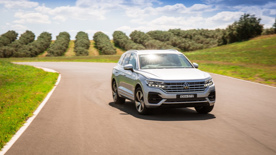 Wide shot of Drive Car of the Year Best Large Luxury SUV 2021 finalist Volkswagen Touareg driven on road