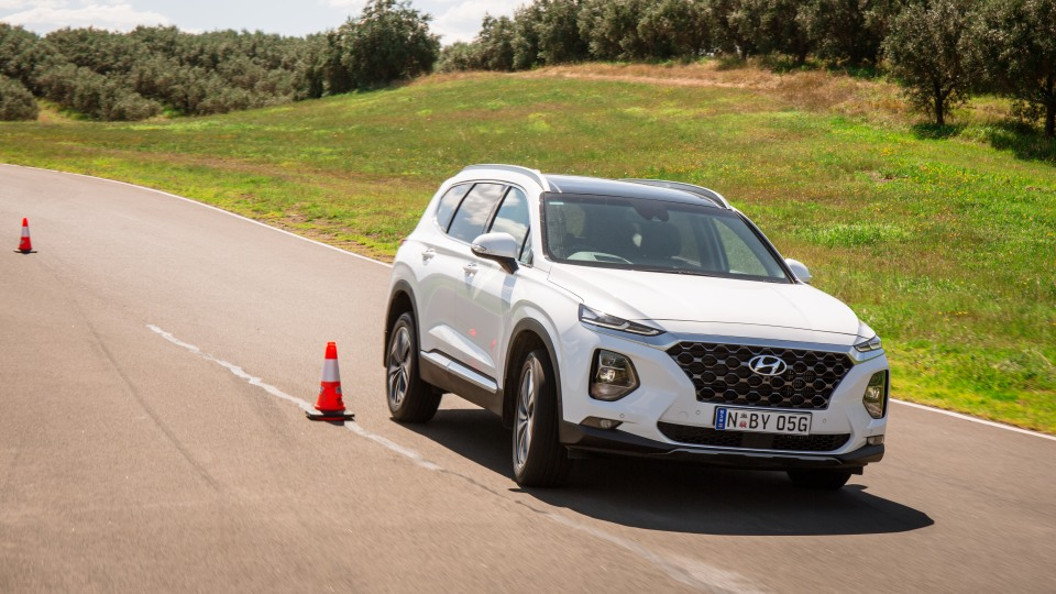 Drive Car of the Year Best Large SUV 2021 finalist Hyundai Santa Fe viewed from front as driven on road circuit