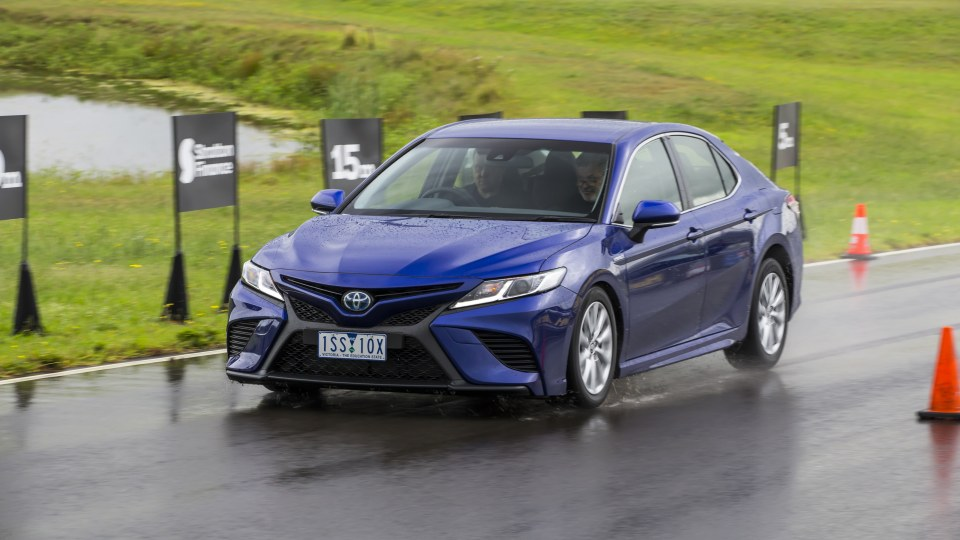 Drive Car of the Year Best Medium To Large Car 2021 finalist Toyota Camry Hybrid on road