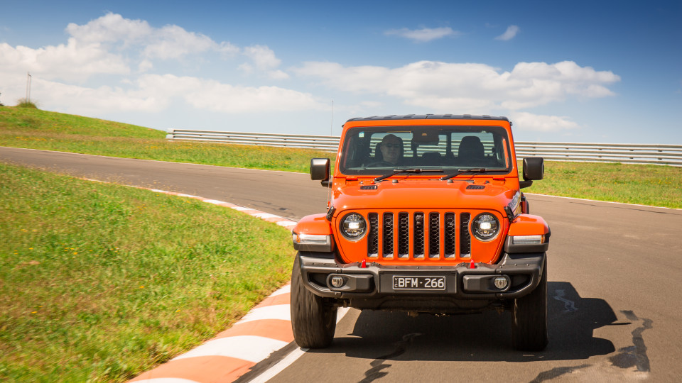 Drive Car of the Year Best Off-Road SUV 2021 finalist Jeep Gladiator Rubicon Jeep drive around a bend as viewed front-on