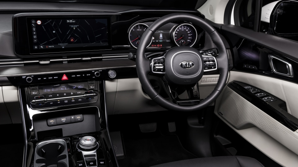 Drive Car of the Year Best People Mover 2021 finalist Kia Carnival driver seat view of steering wheel, dashboard and infotainment system