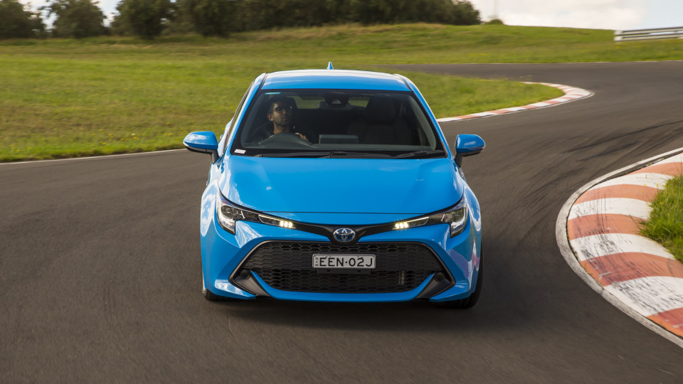 Drive Car of the Year Best Small Car of 2021 finalist Toyota Corolla Hybrid Hatch front view on road.